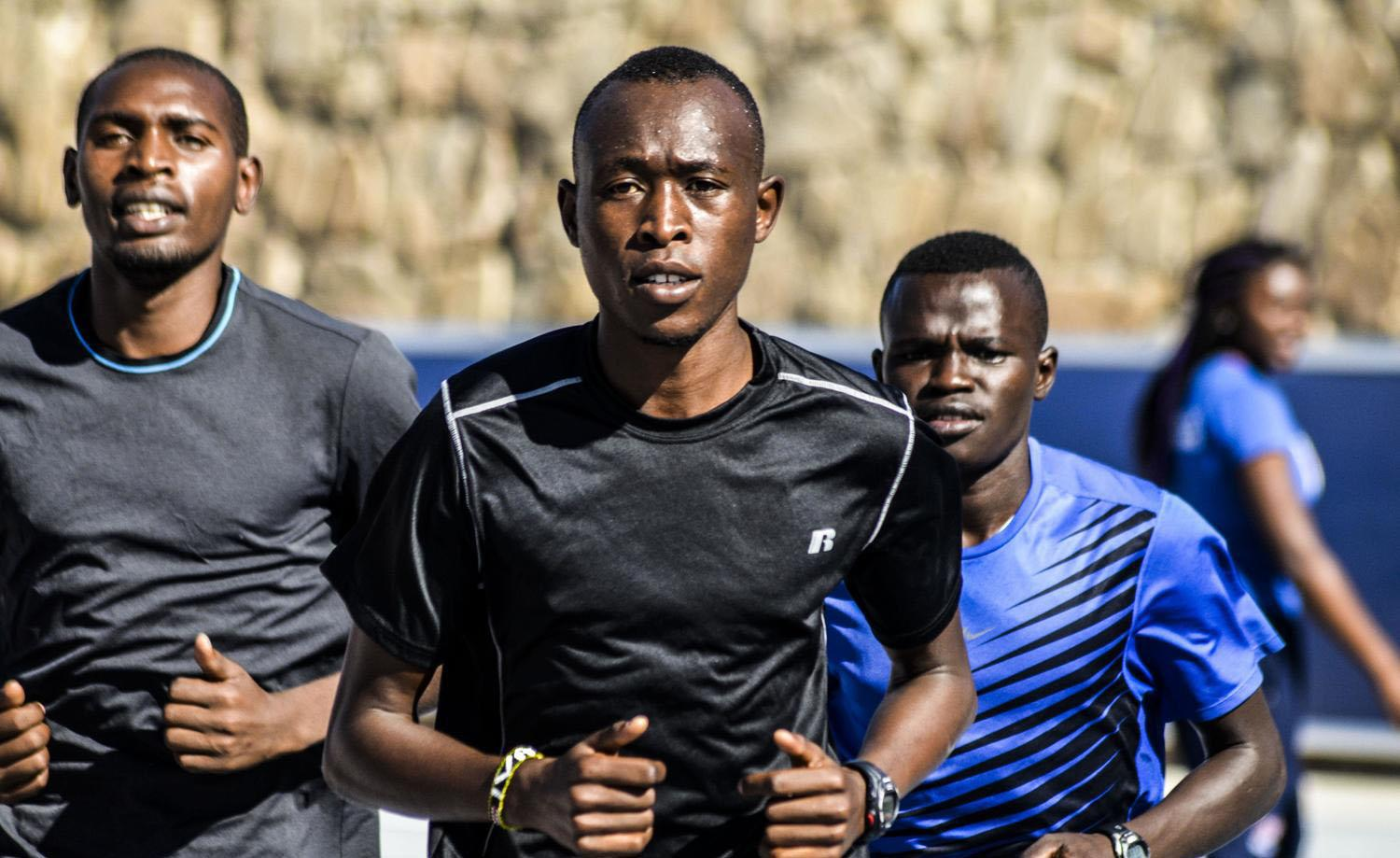 Senior Evans Kiprono leads a pack of runners during a 2015 practice at Kidd Field.