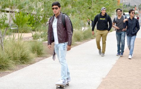 Skateboarders, longboarders and penny boarders often cruise between pedestrians on campus to get to class.