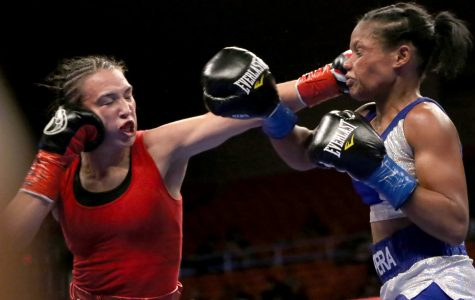 Han successfully defends her title against Martinez