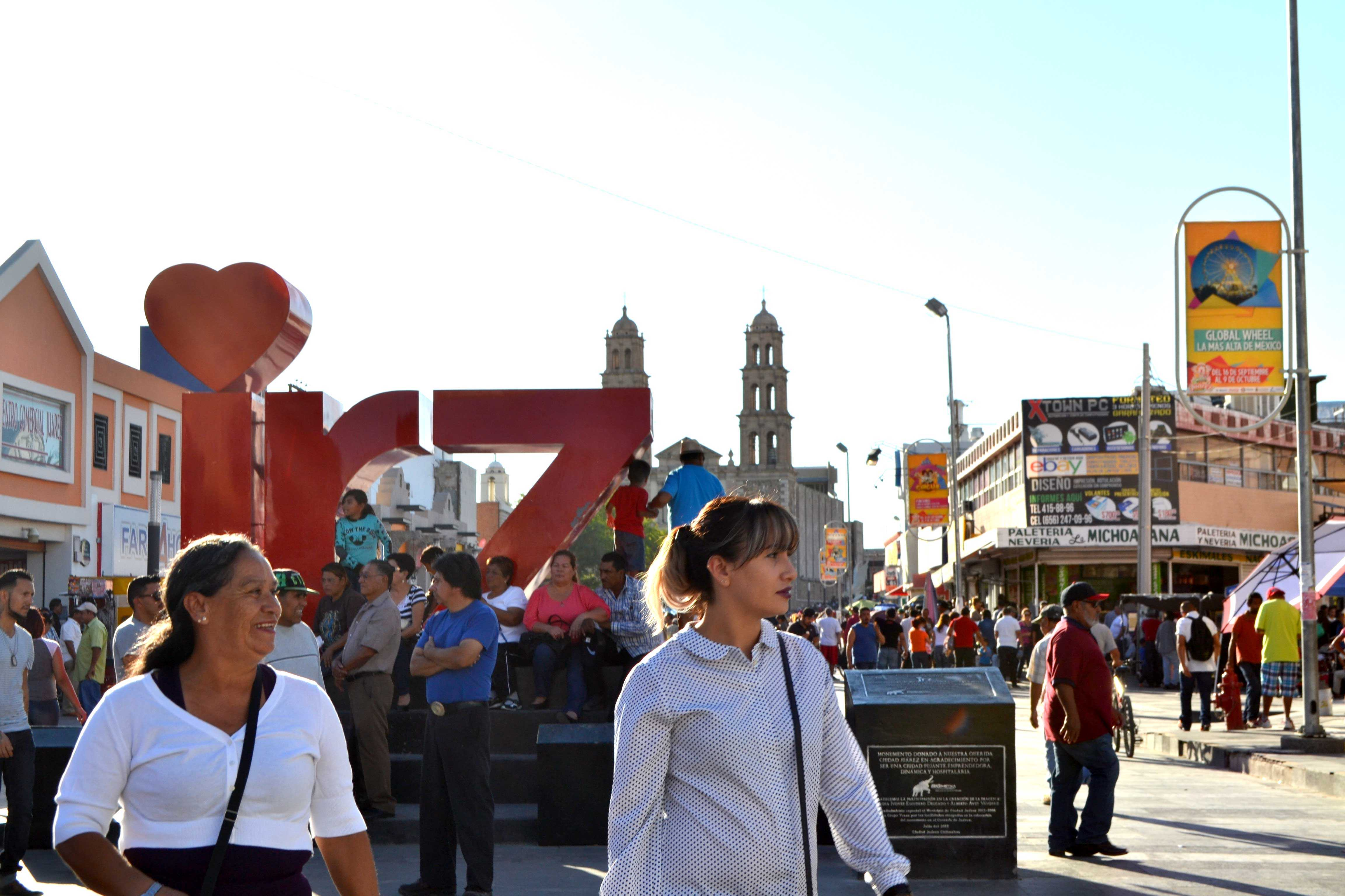 Two women stand in the middle of downtown Juárez, near the Our Lady of Guadalupe Cathedral.