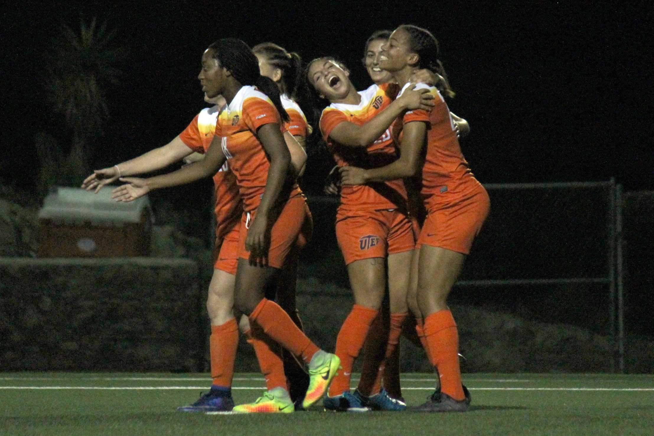 Miners celebrate their victory against Southern Miss 5-0