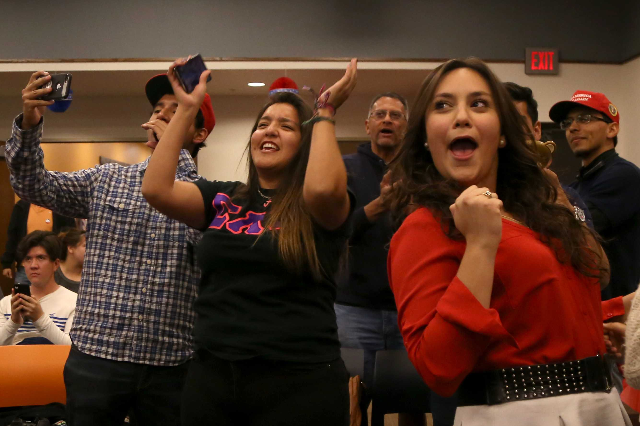 Members of the UTEP College Republicans cheer after hearing CNN projections of Trump ahead in the polls.