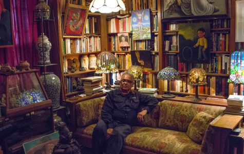 Juan Sandoval surrounded by his collection at his apartment.