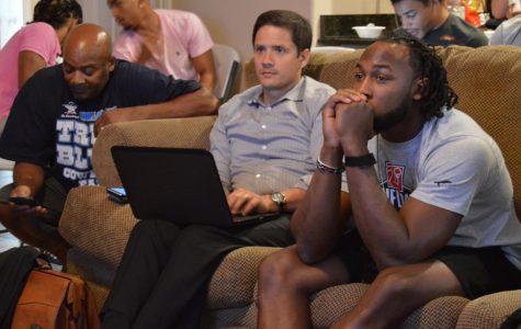 Aaron Jones and agent Chris Cabott watch the NFL Draft.