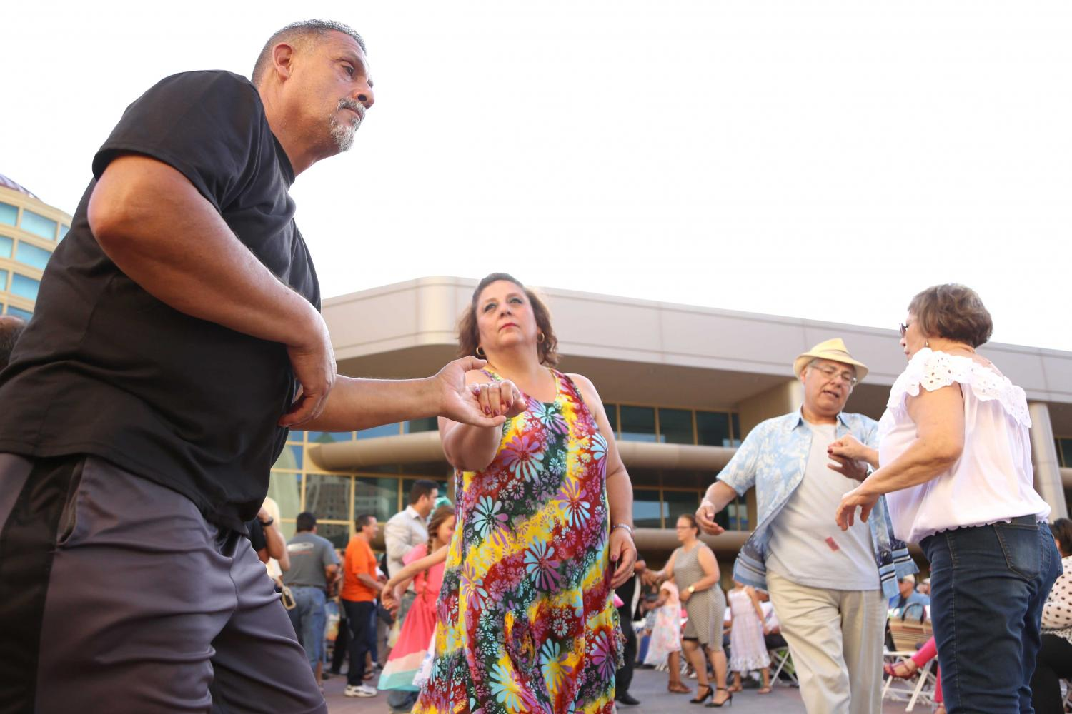 Two couples dance to the music at the Civic Center Plaza on Friday, June 2.