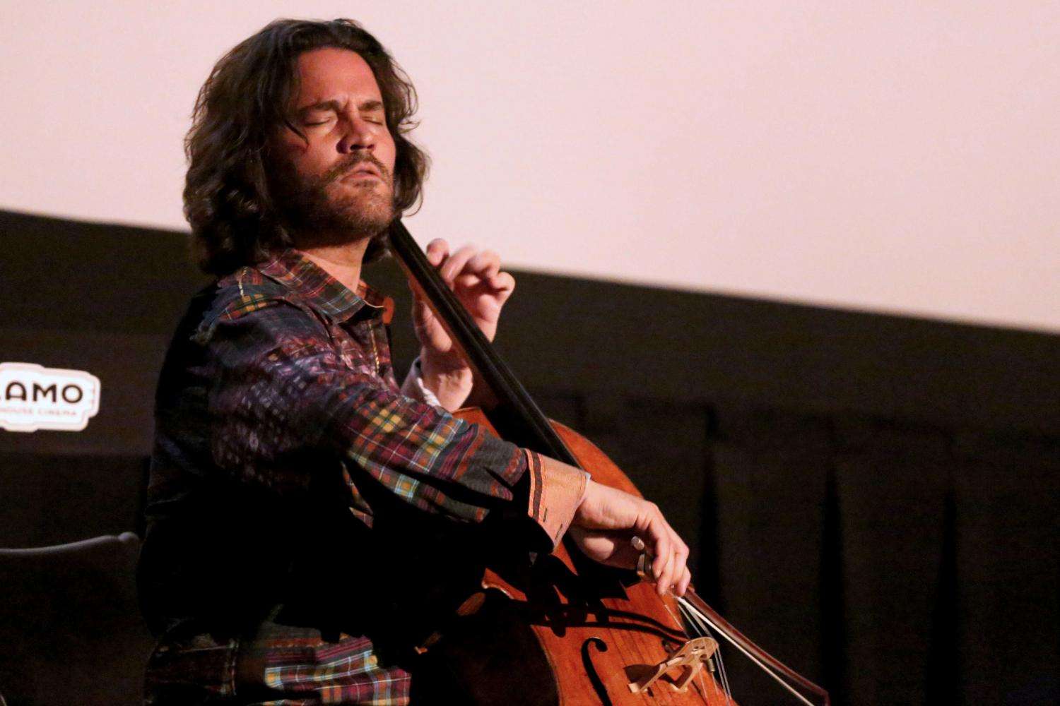 Zuili Bailey plays his 325 year old cello before the showing of Goldfinger at the Alamo Drafthouse.