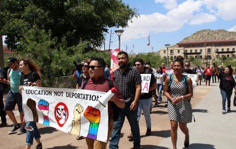 Protestors march to Natalicio's office.