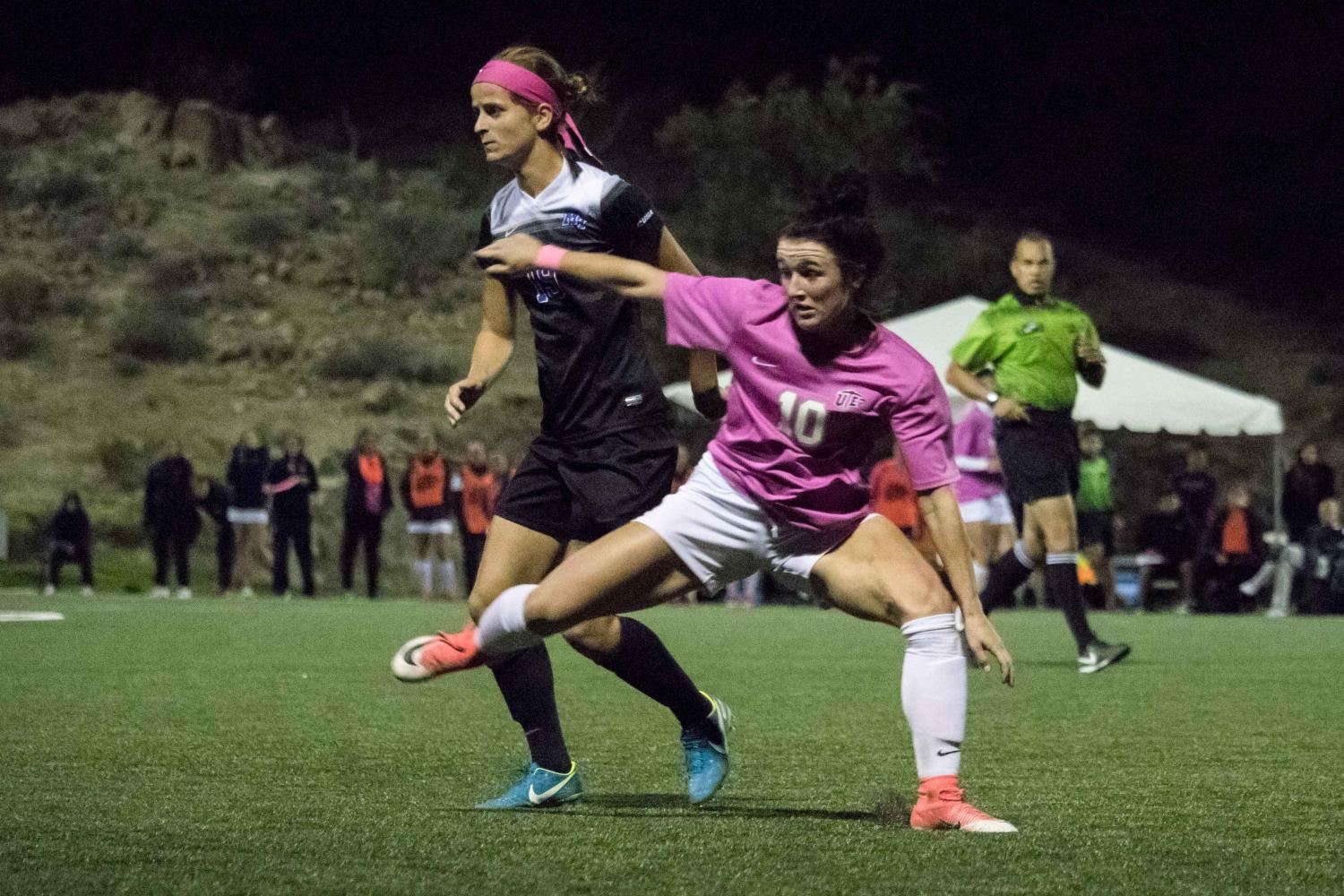 UTEP women's soccer player Vic Bohdan lunges forward after stealing away the ball from Middle Tennessee.