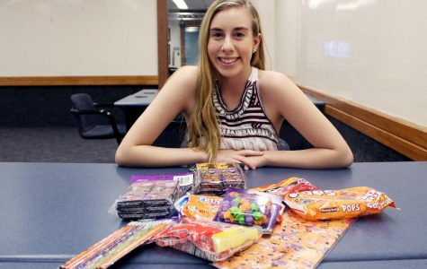 Junior biological sciences major Karina Monticone delivers Halloween candy and presents to underprivileged individuals.