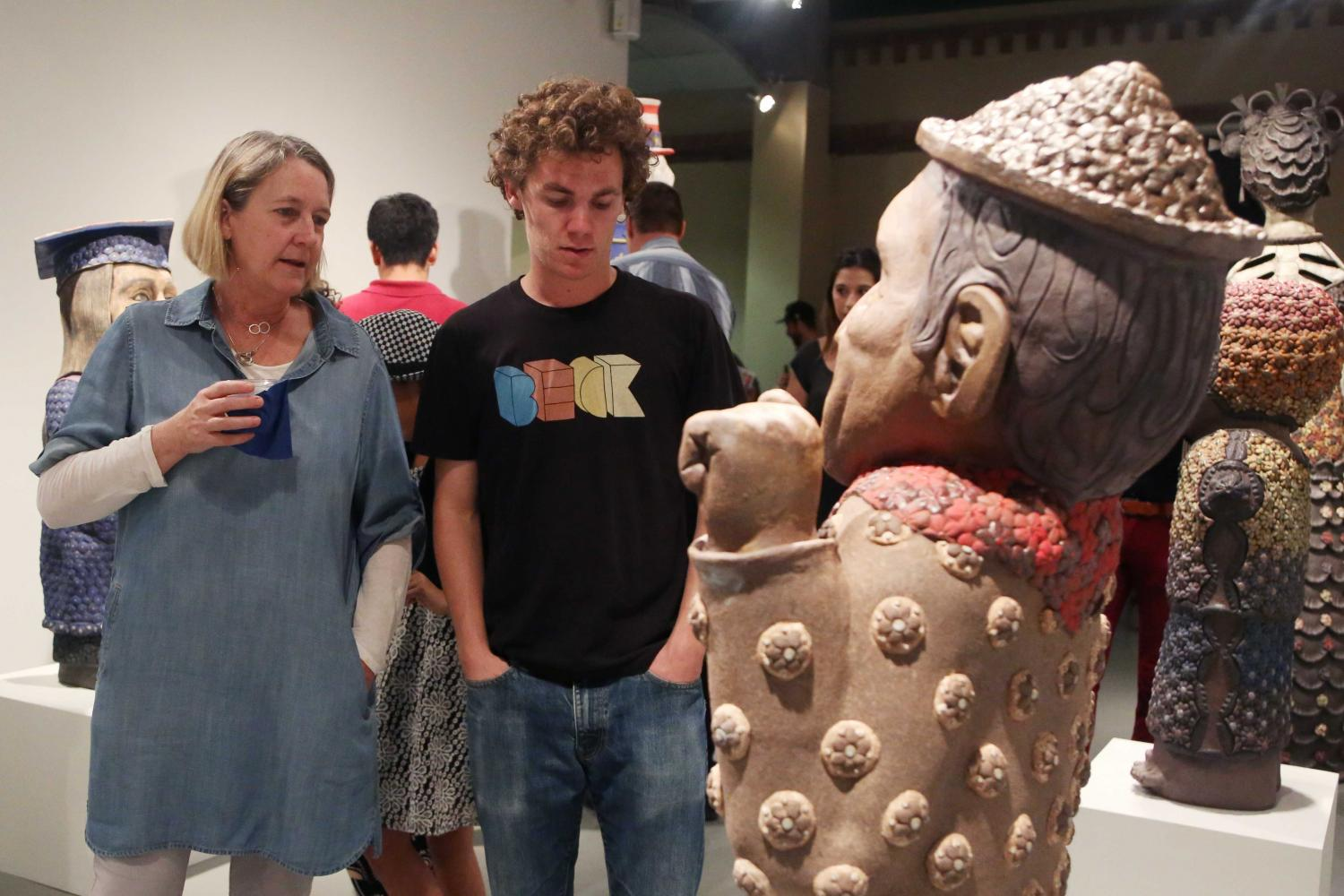 Drawing+lecturer+Alexandra+McGovern+observes+one+of+Rodriguez%27s+ceramic+works.