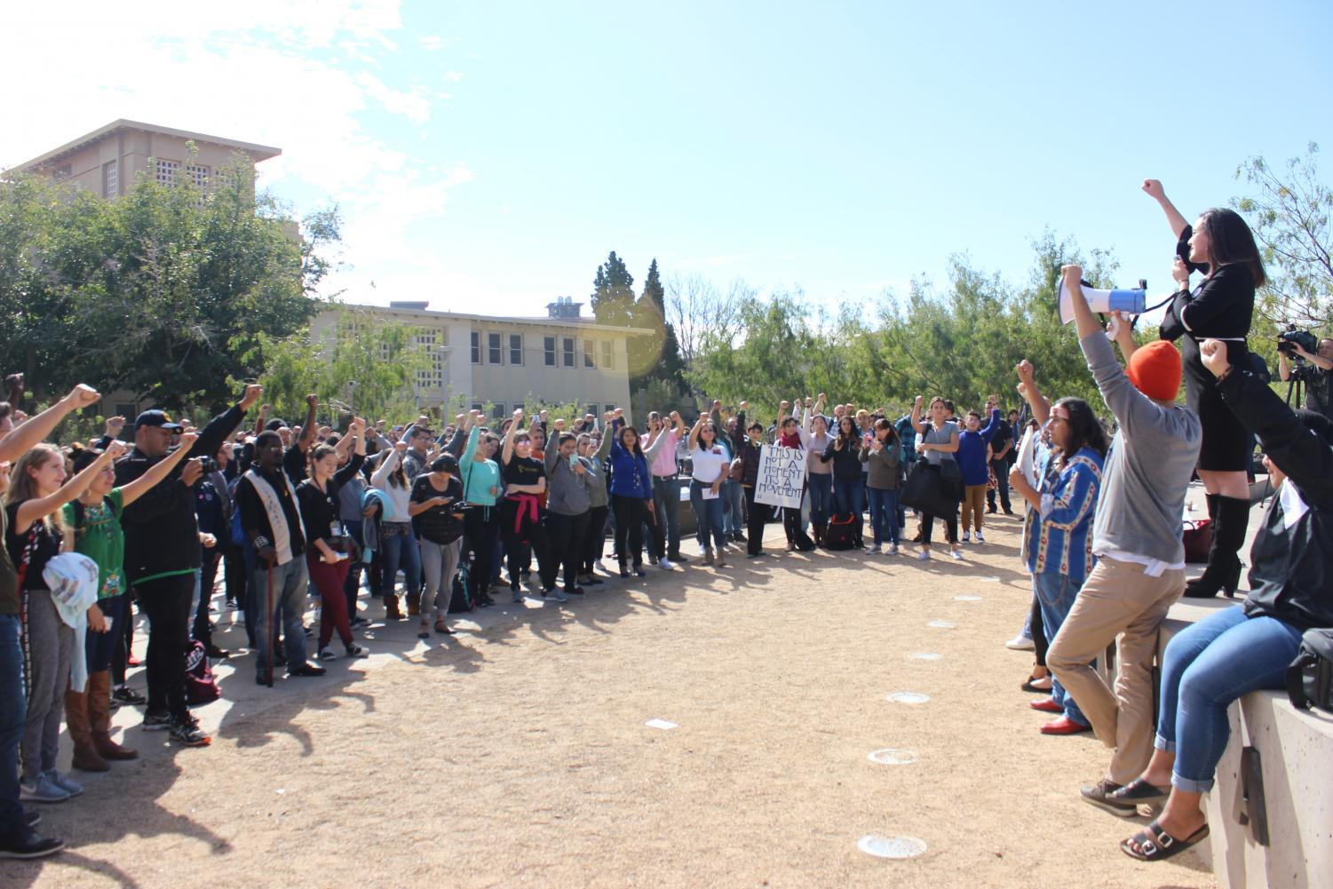 Over+100+students+and+supporters+of+the+protest+gathered+around+Centennial+Plaza.
