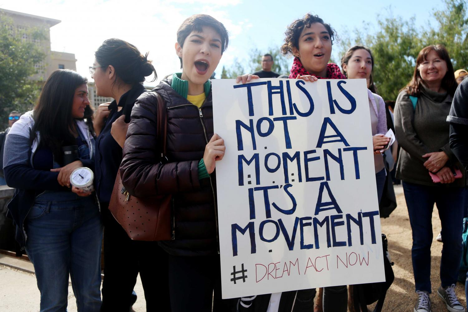 A+student+holding+a+sign+in+support+during+the+walk+out+where+Utep+students+walked+out+of+class+in+support+of+DACA+and+the+Dream+act.