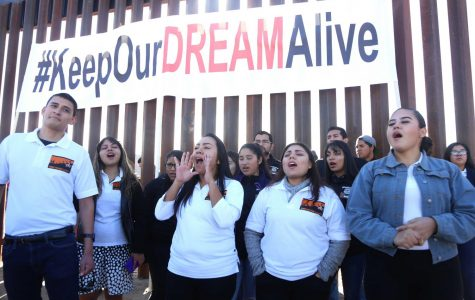 The Border Dreamers Alliance chant along the dreamers on the other side of the fence that were deported on Sunday, Dec. 10, 2017