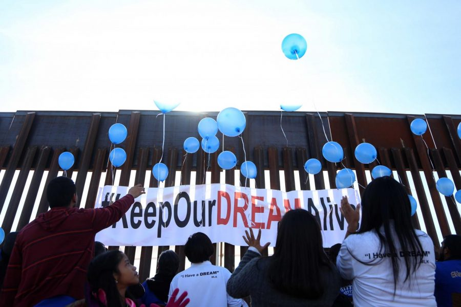 Families release blue balloons that symbolize that the walls weren't going to destroy the union between the families on Sunday, Dec. 10, 2017.