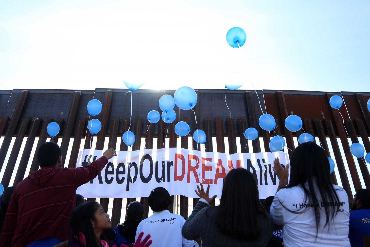Families+release+blue+balloons+that+symbolize+that+the+walls+weren%27t+going+to+destroy+the+union+between+the+families+on+Sunday%2C+Dec.+10%2C+2017.