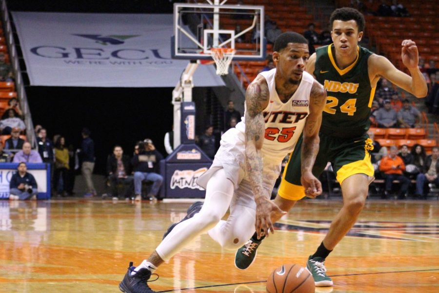 Keith Frazier goes past his defender as he leads the Miners in scoring, 18 points.