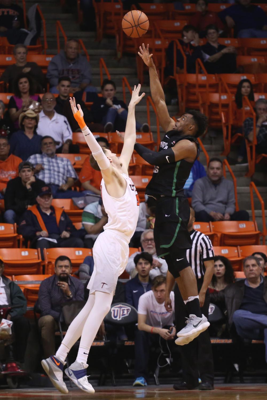 Matt+Willms+plays+defense+as+he+attempts+to+block+the+shot.
