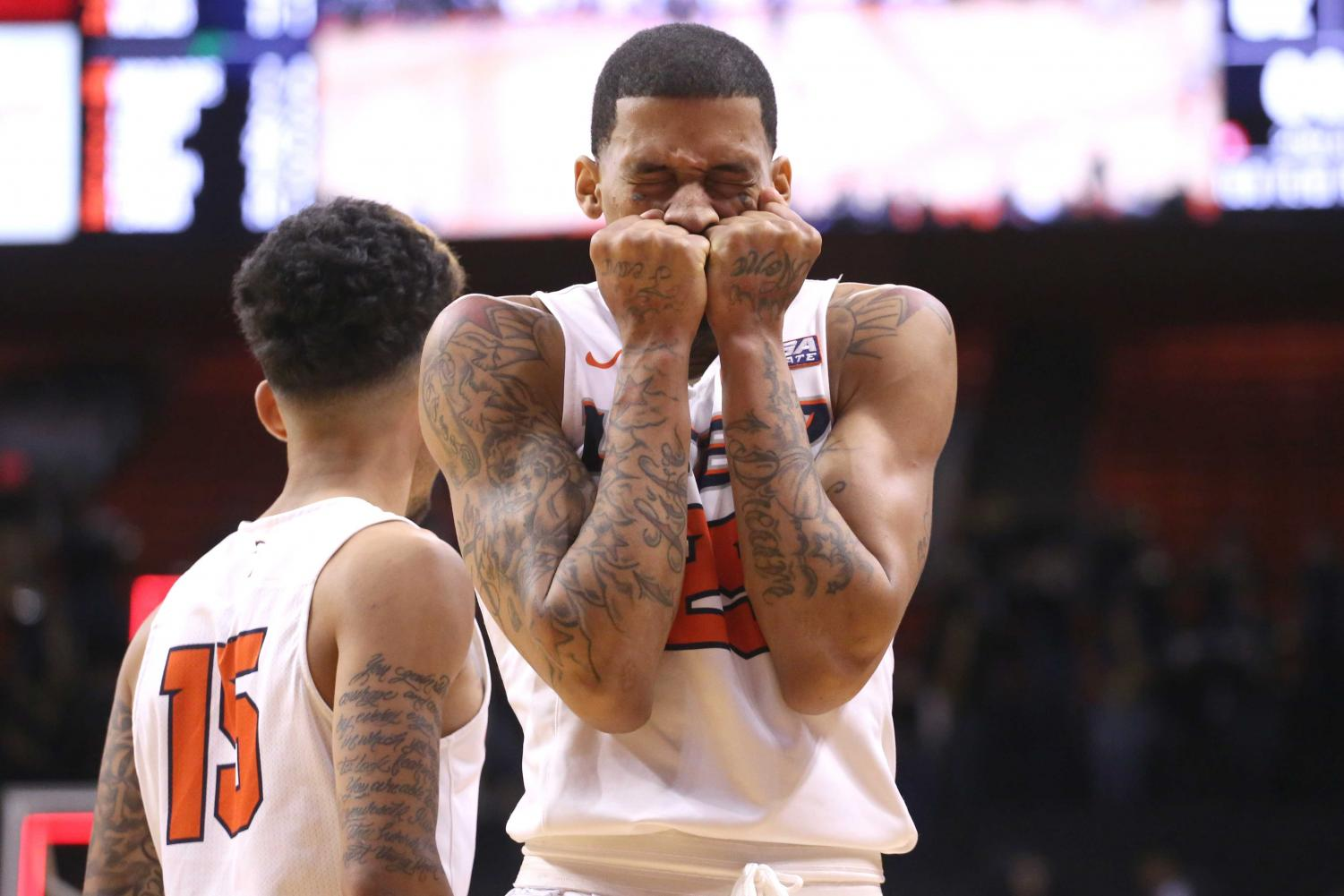 Keith Frazier covers his mouth after Paul Thomas missed a game winning shot.