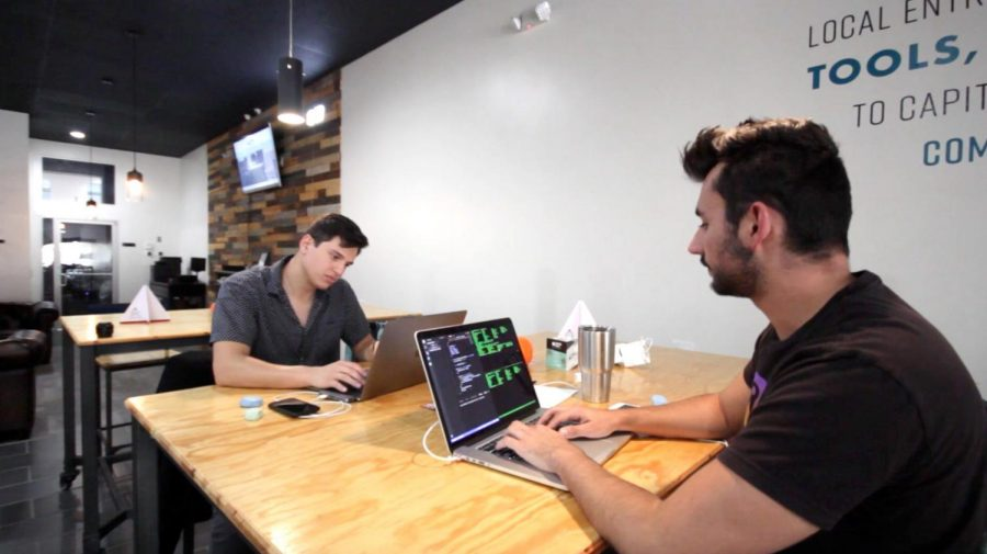 Bean Parabeac  co-founders work on their app at the CoWork Oasis offices.