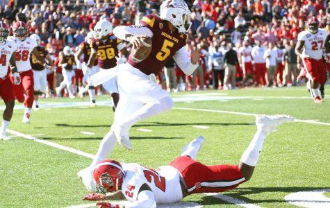 ASU quarterback Manny Wilkins avoids NC State defender Shawn Boone.