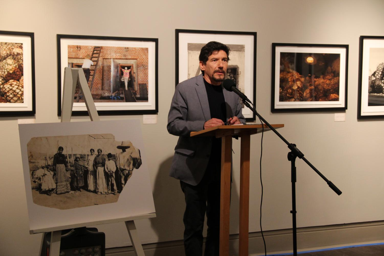 "Photographer Joel Salcido speaks at the opening reception for ""Aliento a Tequila,"" a series of photographs that narrate Salcido's expedition on the making of tequila in the state of Jalisco, Mexico."