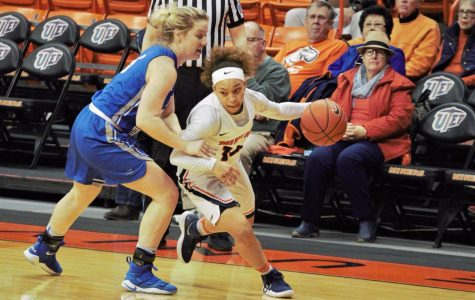 UTEP guard Faith Cook dribbles the ball past Middle Tennessee's Anna Jones.