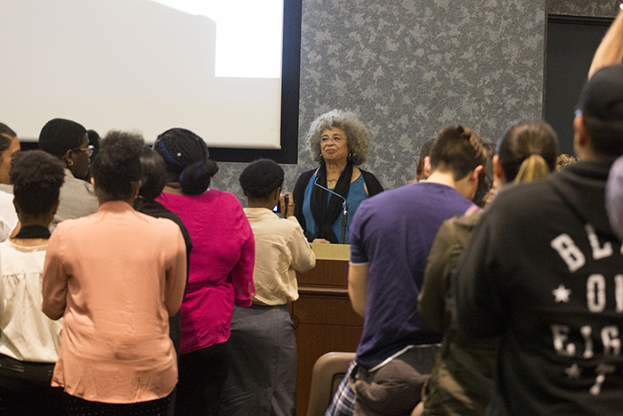 Attendees of Angela Davis' lecture, at UGLC on Wednesday, Feb. 7, welcome her with a standing ovation.