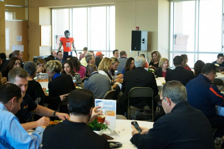 Media members, coaches' families, and attendees enjoy a lunch on UTEP's annual signing day luncheon at the Larry K. Durham Center.