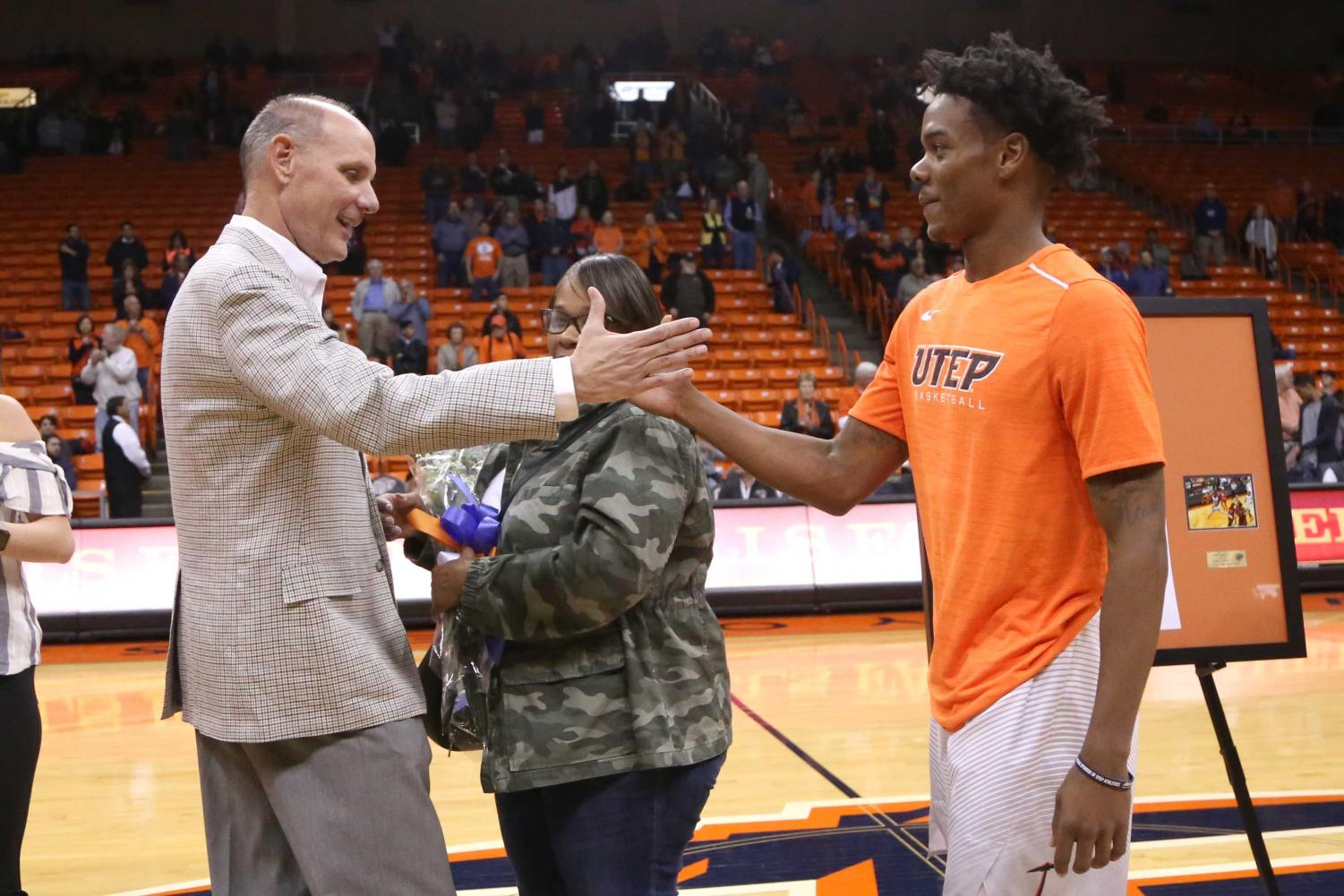 Interim+head+coach+Phil+Johnson+says+goodbye+to+the+tenth+leading+scorer+in+UTEP+basketball%2C+Senior+guard+Omega+Harris.+