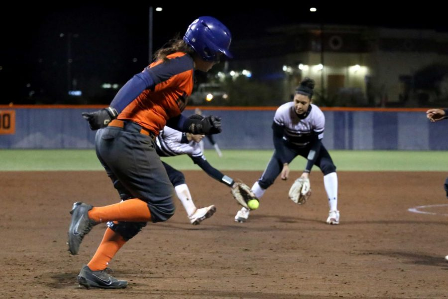 Junior Kacey Duffield attempts to advance on base.