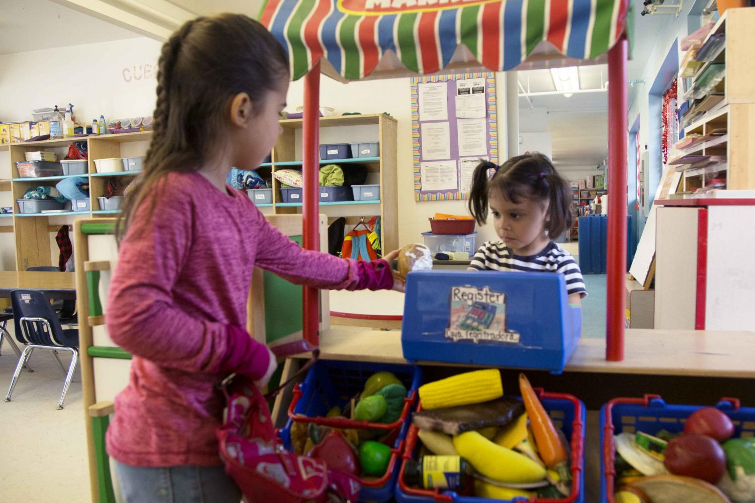 Two sisters, Lexie Rangel and Addison Rangel, play at the YMCA's University Heights Early Learning Academy.