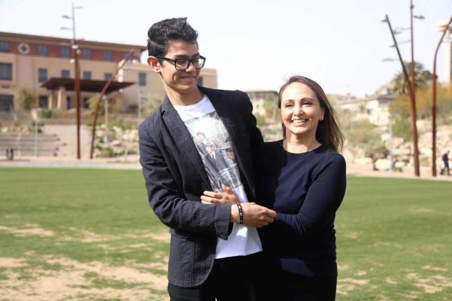 Maria Fuentes, a public health graduate student, hugs her son Darío Barrera who has autism. Fuentes was inspired to create the event UTEP Lights Up Blue for Autism Awareness on April 2.