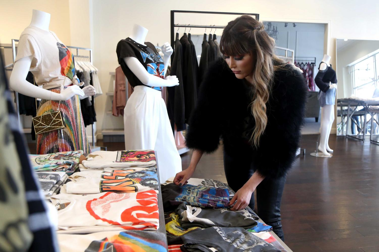 Gesuina Arianna Legaspy arranges clothes at her boutique GAL Fashion. The boutique is located at 5860 N Mesa St. and open Monday-Saturday from 10 a.m. - 7 p.m.