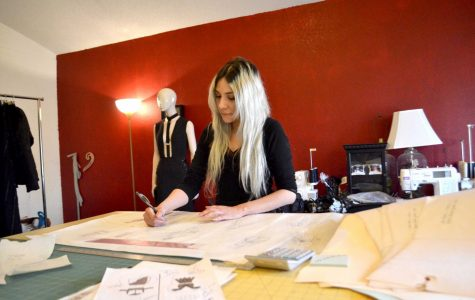 Lizette Arenas, owner of Obscurity Designs, works on one of her most recent clothing designs.