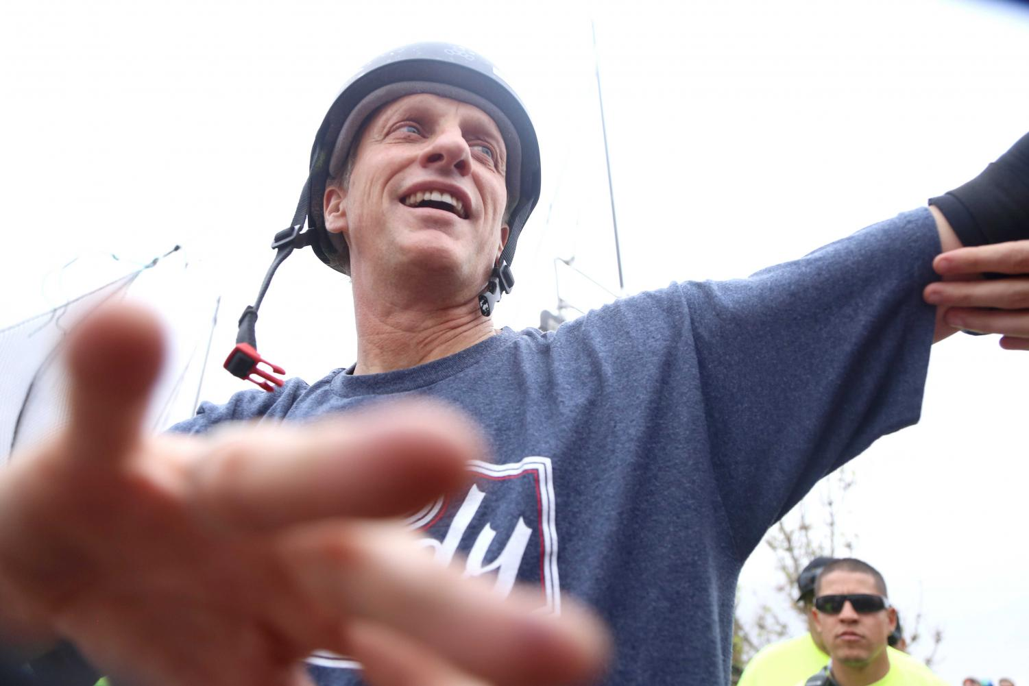 Tony+Hawk+high+fives+the+crowd+after+he+skates+at+the+Pakitu+Skate+Plaza+on+Saturday%2C+March+24.+