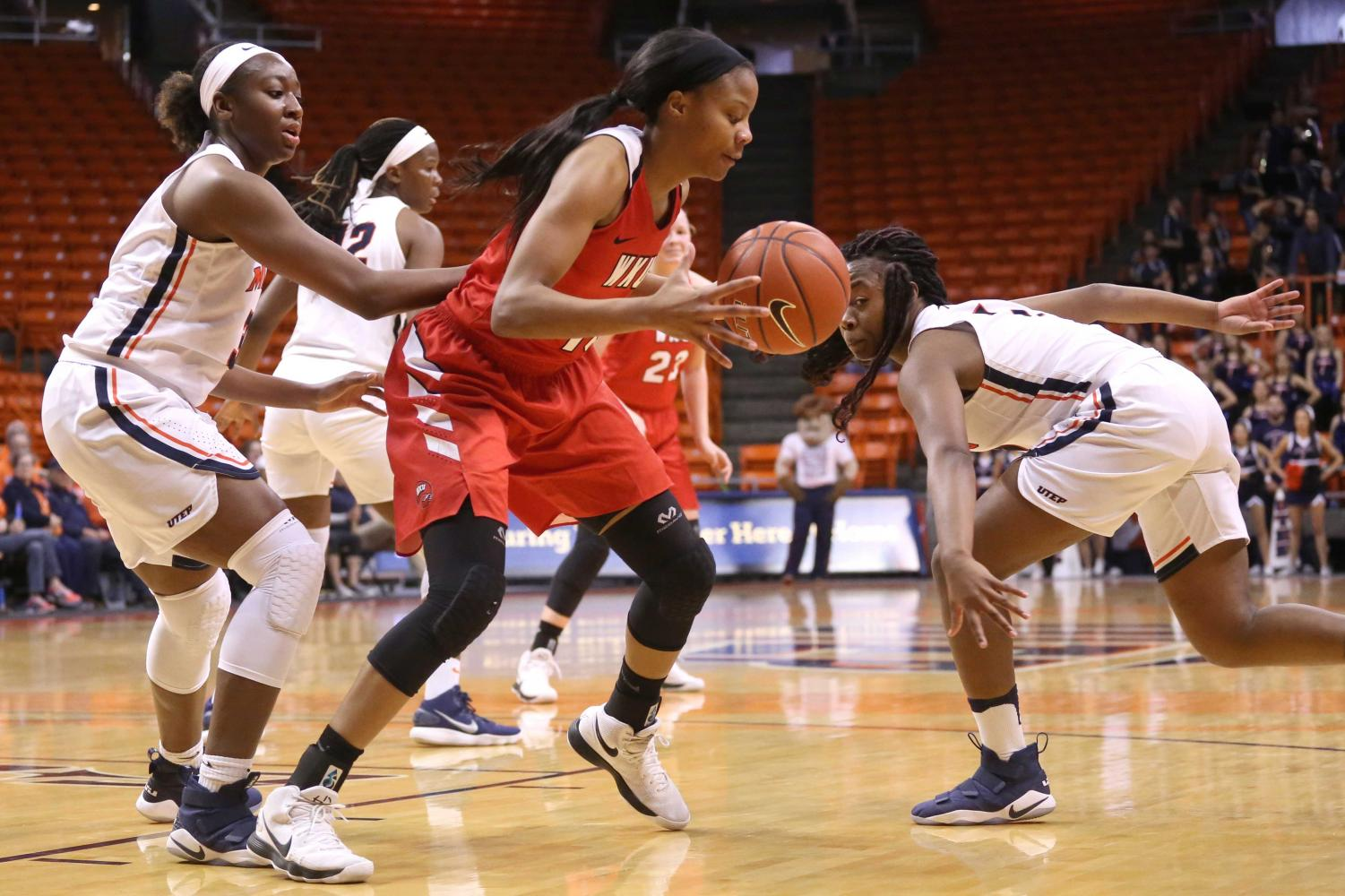 Sophomore+guard+Roeshanda+Patterson+attempts+to+steal+the+ball+from+WKU+on+Saturday%2C+March+3+at+the+Don+Haskins+Center.