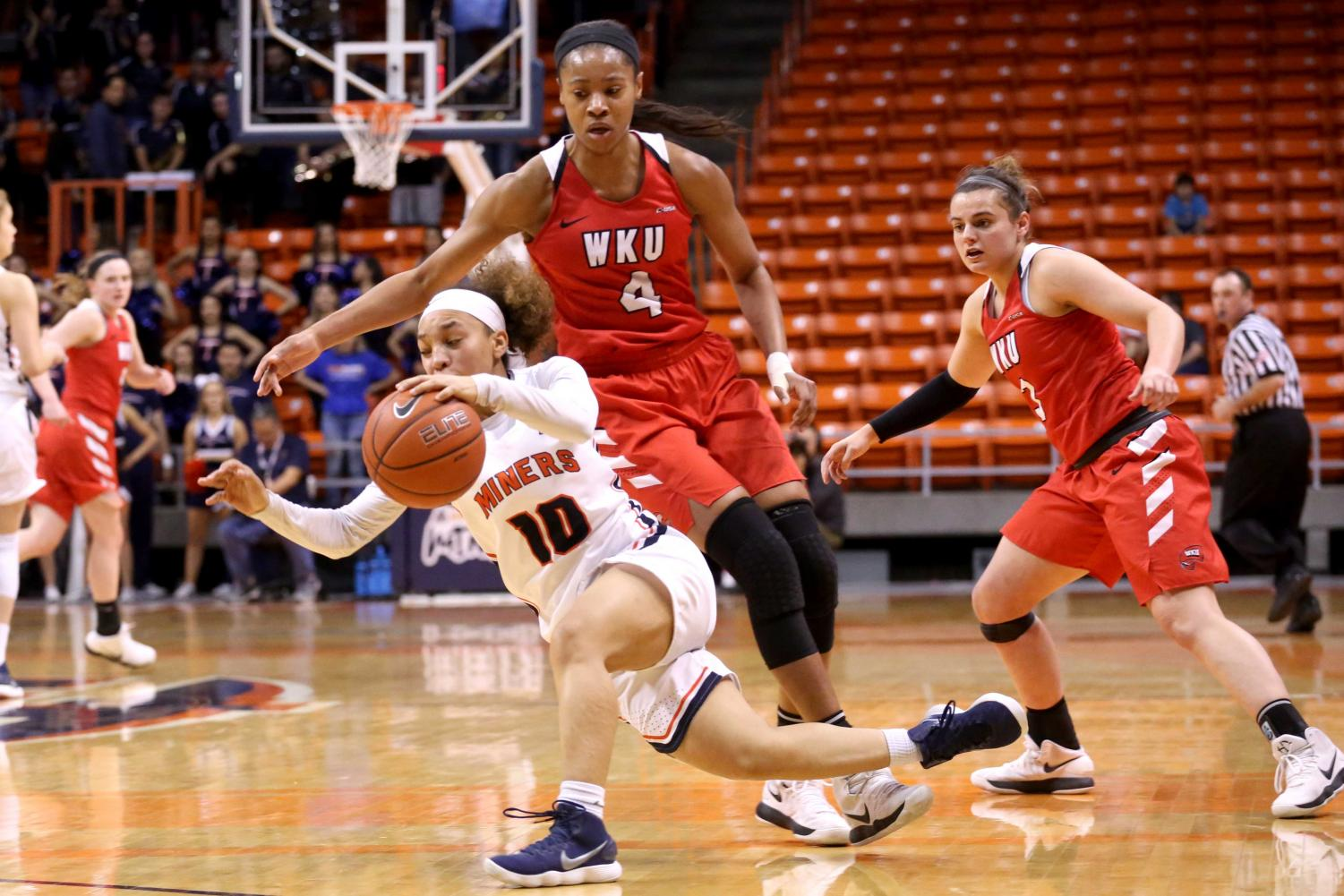 Sophomore+guard+Faith+Cook+is+tripped+by+WKU%27s+Dee+Givens+on+Saturday%2C+March+3+at+the+Don+Haskins+Center.