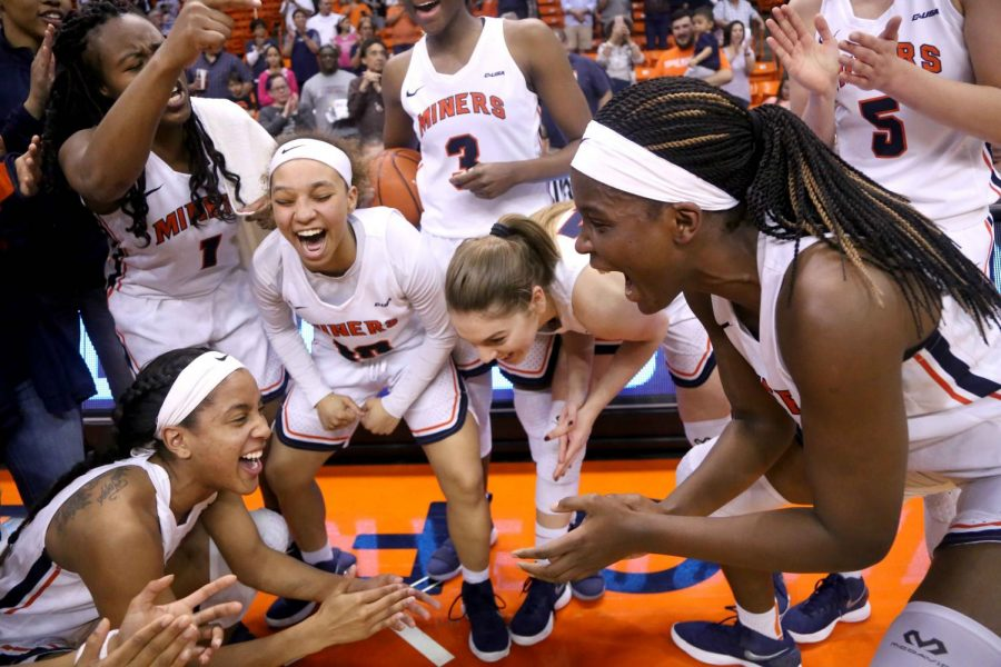 The Miners celebrate their 80-75 win against WKU on Saturday, March 3 at the Don Haskins Center.