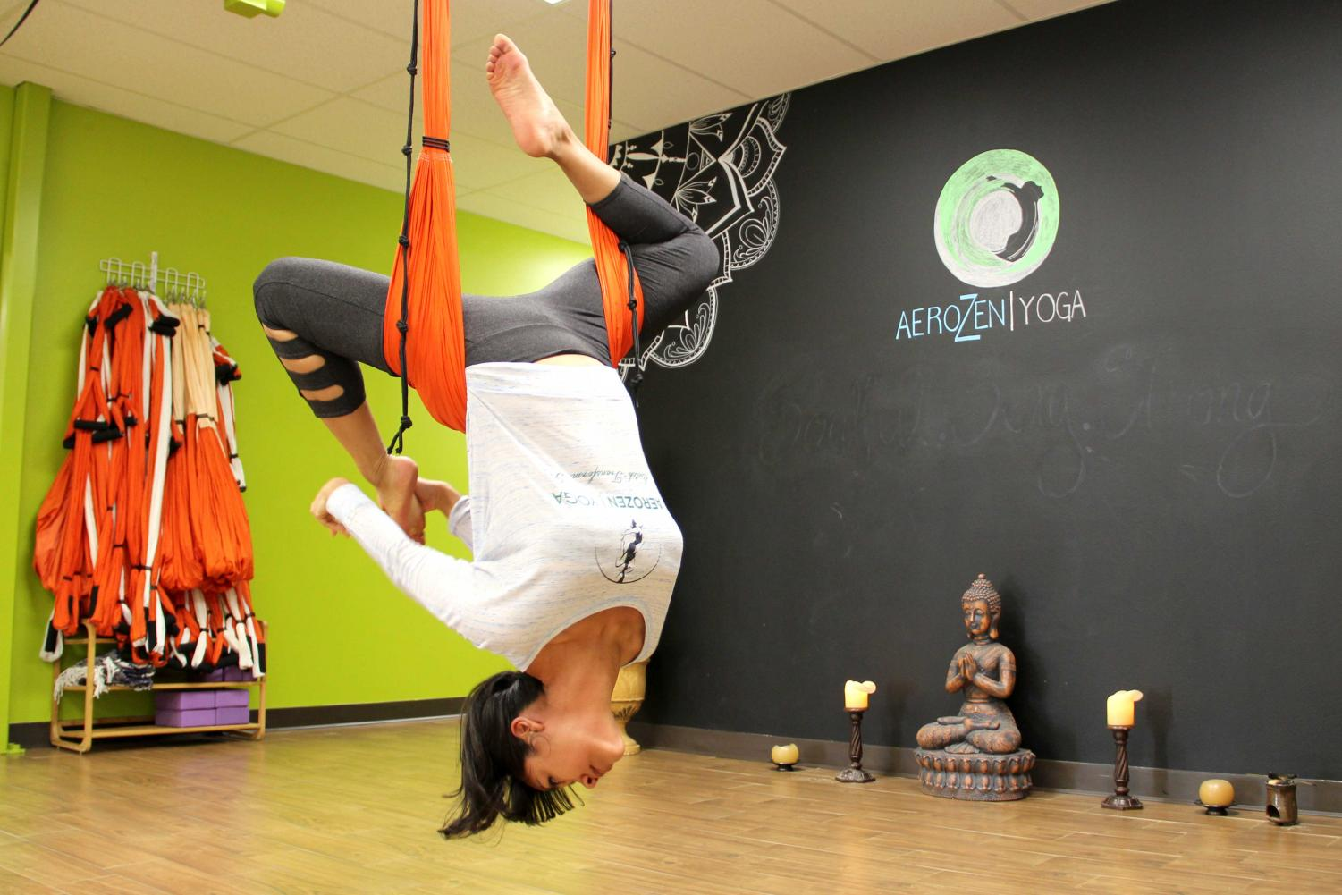 Instructor and owner of AeroZen Yoga Nahsyelli Elena Hernandez demonstrates the advanced techniques used during AeroYoga class at the studio located in 10110 Montwood Drive