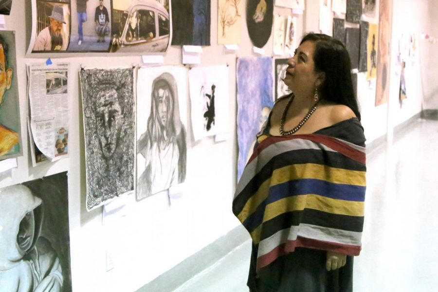Betsabee+Romero+looks+at+the+art+work+of+students+at+the+Rubin+Center+for+the+upcoming+annual+Juried+Student+Art+Exhibition.+