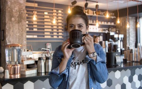 Pamela Azaeta owner of District Coffee runs the shop she and her husband opened in March 2018.