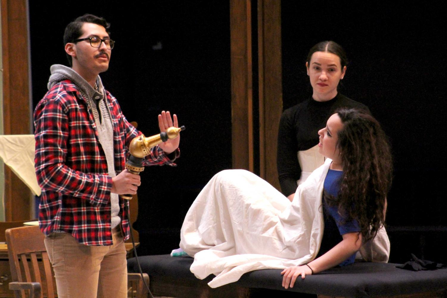 """The UTEP cast for """"In the Next Room"""" rehearses at the Wise Family Theatre."""