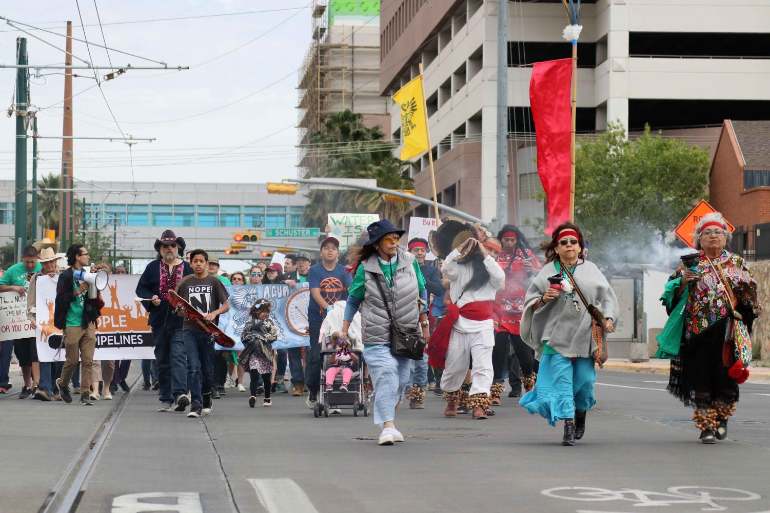 Marchers head down Oregon St. from Centennial Plaza on Sunday, April 22 for the March for Planet Earth.