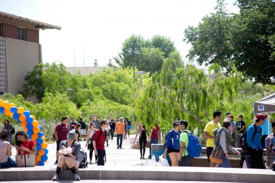Students walk to and from class by the first Miner Fest  on Wednesday, April 18 at Centennial Plaza.
