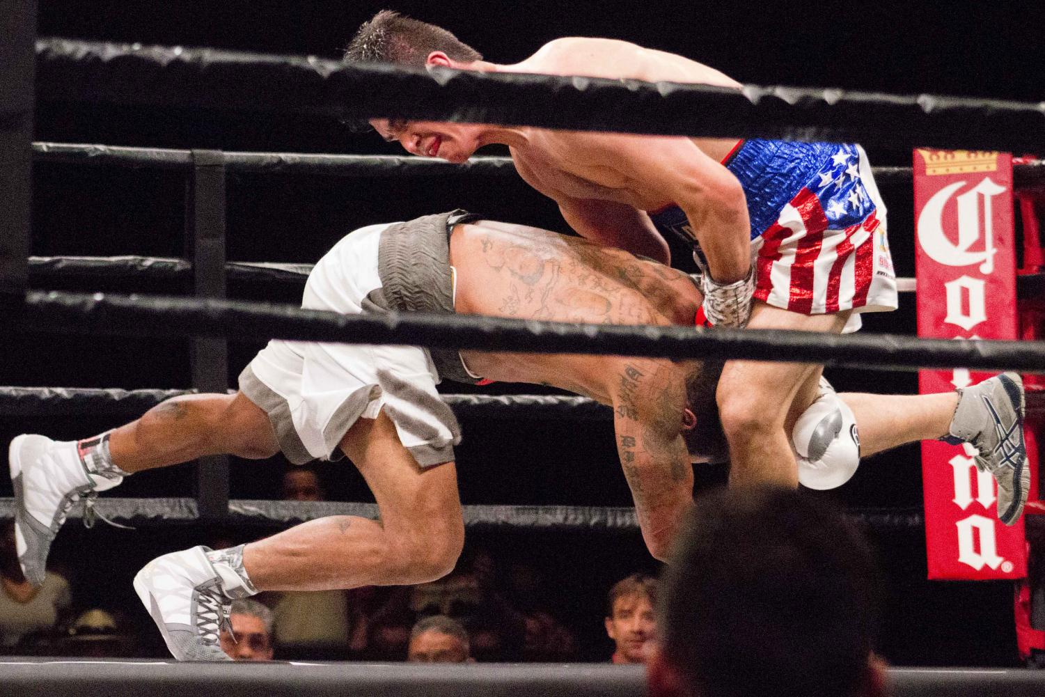 Anthony Dirrell dives into Abraham Han at Premiere Boxing Champions on Saturday, April 28 at the Don Haskins Center.
