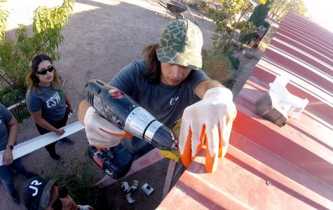 Francisco Bunsow, a sophomore in Construction Engineering and Management at UTEP helps drill in a gutter alongside other Engineering for a Sustainable World members. The group worked on a rainwater harvesting system for  Las Pampas residents, a colonia outside of Presidio, Texas.
