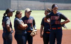 Softball uses momentum down final stretch