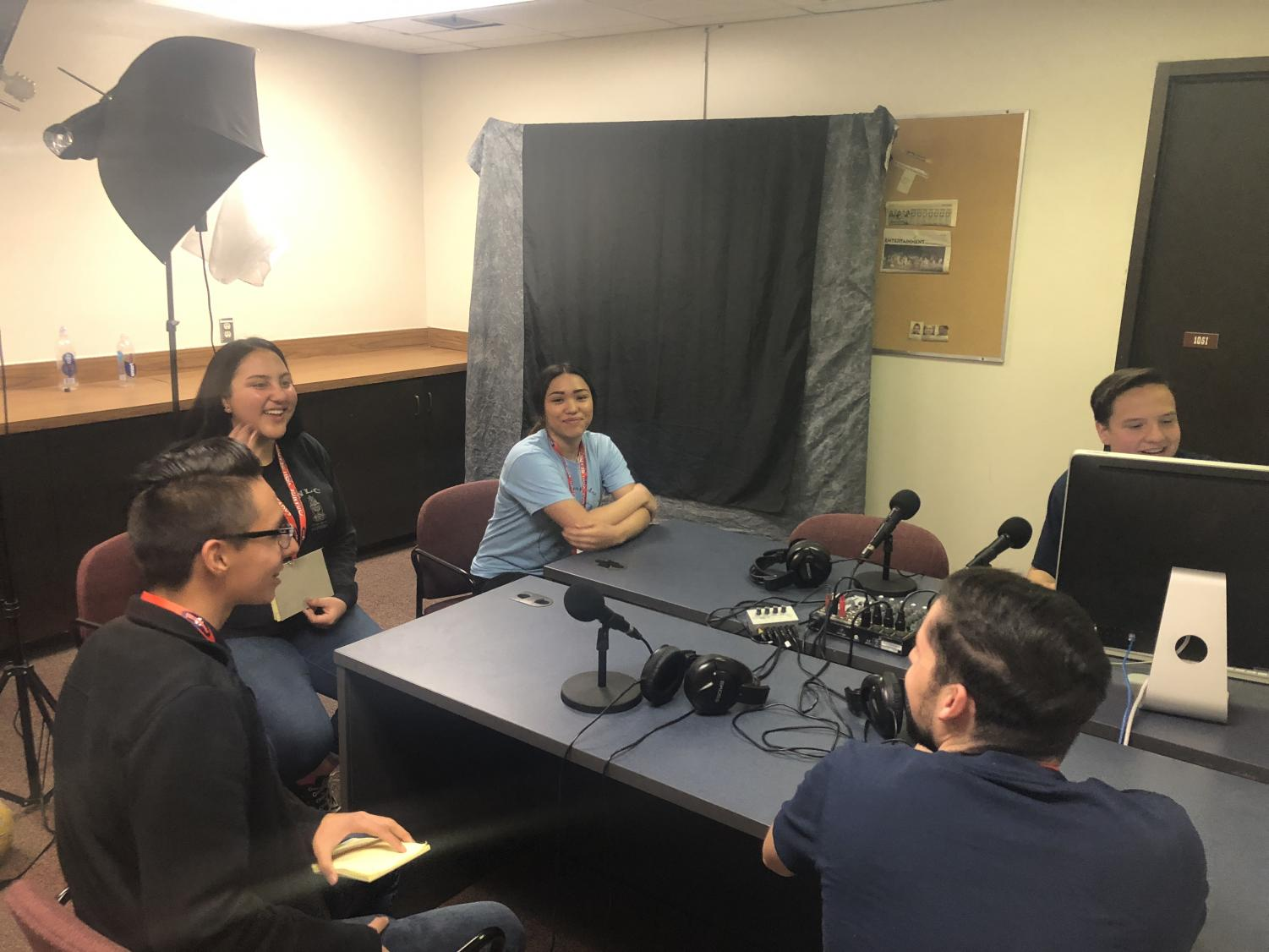 Students+work+with+Adrian+Broaddus%2C+copy+editor%2C+and+Jeremy+Carranco%2C+sports+editor%2C+on+a+podcast.