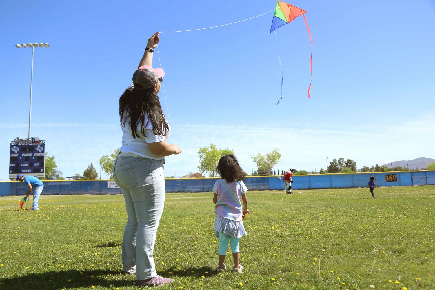 Voices United Executive Director Ambar M. Gutierrez flies a kite with her daughter at the first annual Kite Festival on Saturday, May 19, at Ernie Rascon Memorial Park.