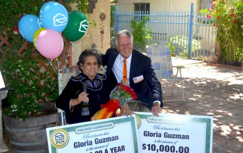 Dave Sayer of the Publishers Clearing House Prize Patrol poses for a photo with prize winner Gloria Guzman.